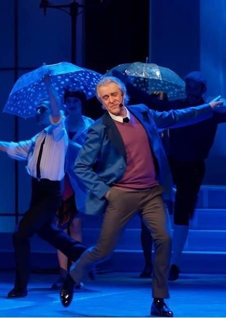 Да пееш под дъжда